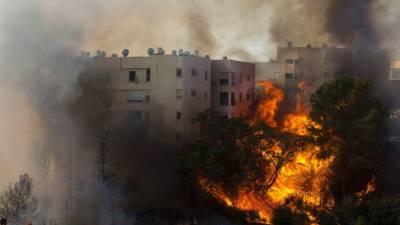 اسرائیلی شہر میں آگ پر قابو نہ پایا جا سکا، 80 ہزار شہری بے گھر