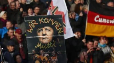 جرمنی میں چانسلر مرکل کے خلاف احتجاجی مظاہرہ