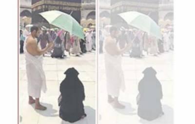 حج کے موقع پر نماز پڑھتی ہوئی بیوی پر شوہر نے سایہ کر دیا